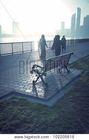 Arab woman taking a walk early in the morning in winter.