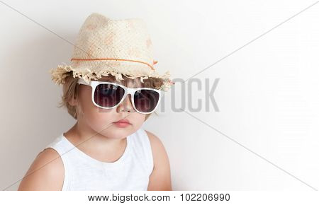 Cute Little Girl In Straw Hat And Sunglasse