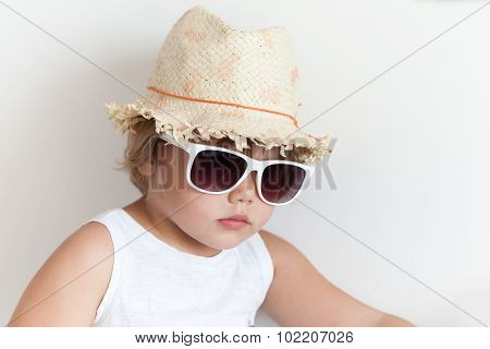 Cute Caucasian Little Girl In Straw Hat And Sunglasses