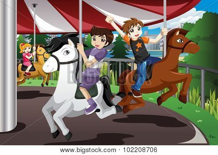 Kids Riding On Merry Go Round