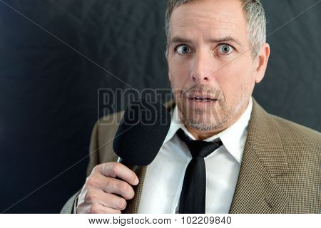 Anxious Man Speaks Into Microphone