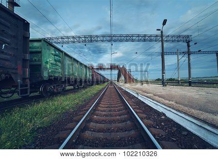 Cargo train platform at sunset. Railroad in Ukraine. Railway station.