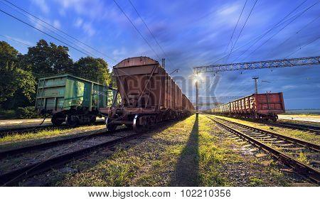 Cargo train platform at night. Railroad in Ukraine. Railway station