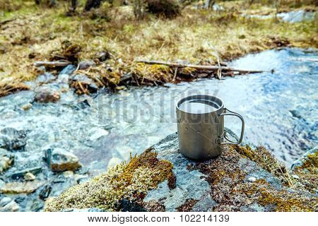 Travel titanium cup. Lunch during the journey to the wild. Camping lifestyle.