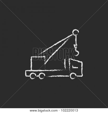 Mobile crane hand drawn in chalk on a blackboard vector white icon isolated on a black background.