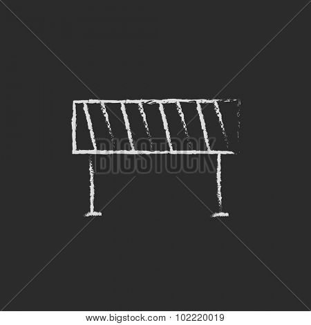 Road barrier hand drawn in chalk on a blackboard vector white icon isolated on a black background.