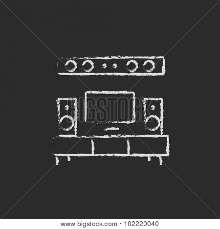 TV flat screen and home theater hand drawn in chalk on a blackboard vector white icon isolated on a black background.