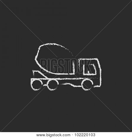 Concrete mixer truck hand drawn in chalk on a blackboard vector white icon isolated on a black background.
