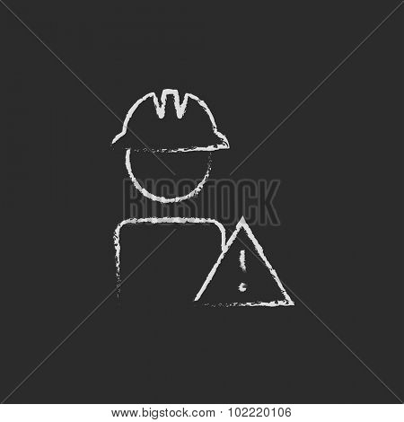 Worker with caution sign hand drawn in chalk on a blackboard vector white icon isolated on a black background.