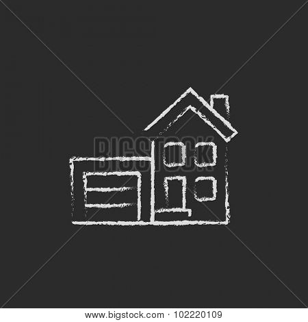 House with garage hand drawn in chalk on a blackboard vector white icon isolated on a black background.