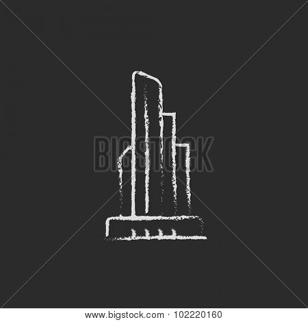 Skyscraper office building hand drawn in chalk on a blackboard vector white icon isolated on a black background.