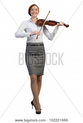 Businesswoman playing violin