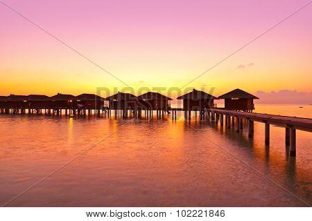 Water bungalows on Maldives island - nature travel background