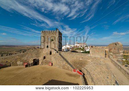 Europe, Portugal, Evora - Monsaraz village, medieval bullring and castle view in the afternoon
