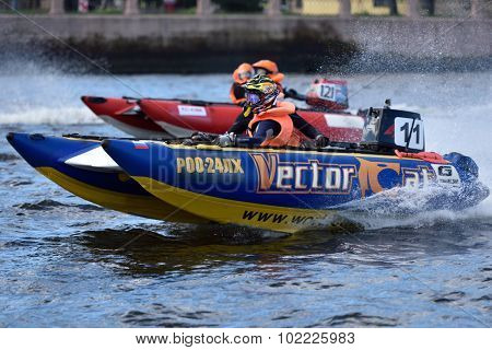 ST. PETERSBURG, RUSSIA - AUGUST 15, 2015: Unidentified riders go to the start of the River marathon Oreshek Fortress race. This international motorboat competitions is held since 2003