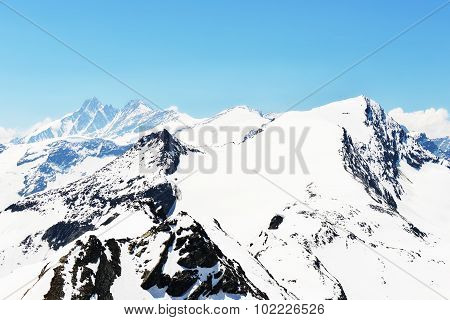 Capped Mountain Peaks