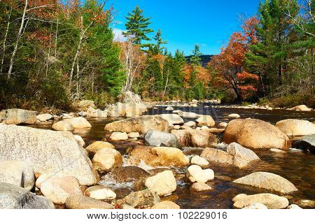 Swift River at autumn in White Mountain National Forest, New Hampshire, USA.