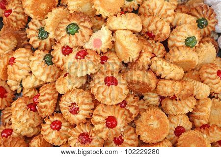 Pastries And Almond Biscuits With Icing And Candied Fruit For Sale In Italian Market