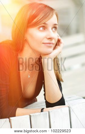 Young thoughtful girl outdoor portrait