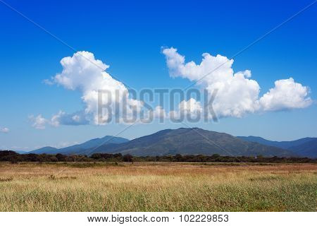 Landscape With Mountain Views And Blue Sky.