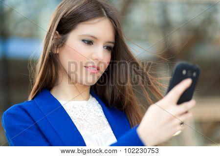 Woman sending a sms