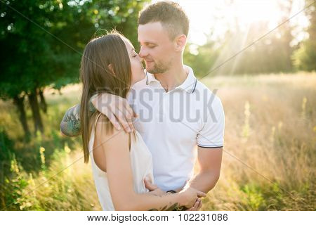 Couple In Love - Beginning Of A Love Story. A Man And A Girl With A Tattoo On The Nature