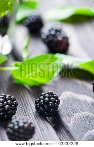 Blackberry on wooden rustic background, closeup view