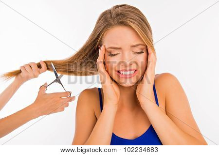 Stylist Cutting Split Ends On Scared Girl