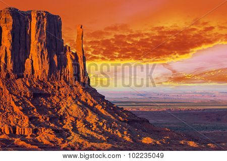 Beautiful dramatic sunset over the West Mitten Butte in Monument Valley. Utah, USA