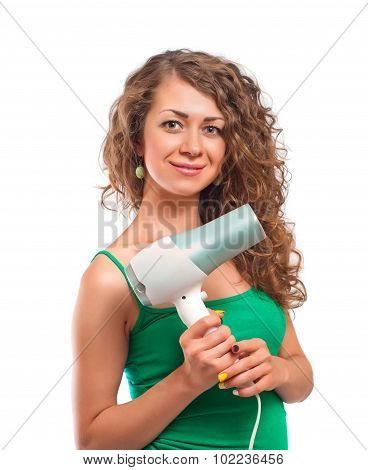 curly woman holding hairdryer