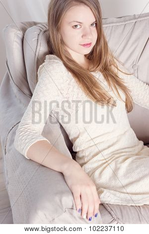 Portrait Of A Stunning Fashionable Model Sitting In Chair