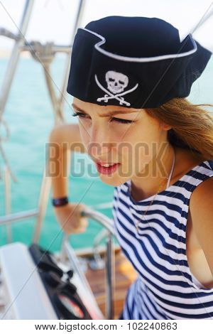 pirate at the helm of a yacht