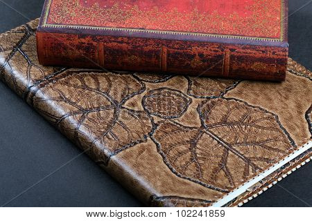Two Leather Cover Notebook On The Table