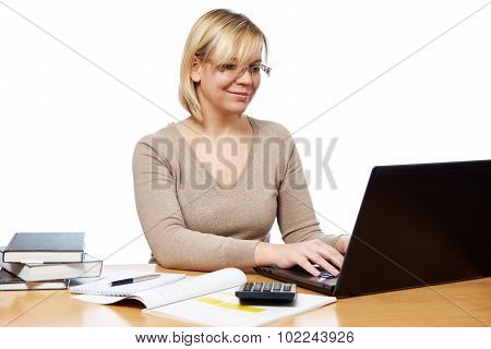 Woman Working With Laptop Computer In Office