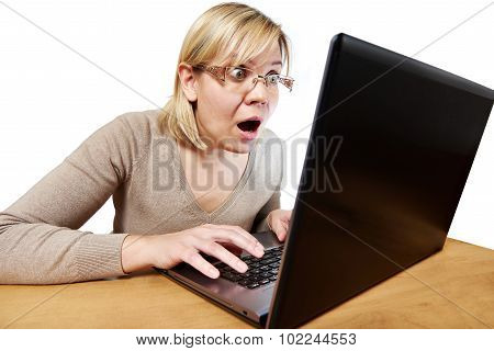 Frightened Woman With Glasses Looking At Laptop