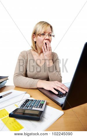 Frightened Woman Accountant With Glasses Looking At Laptop