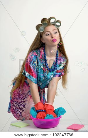 Woman Housewife Wipes In The Kitchen, In A Bright Robe