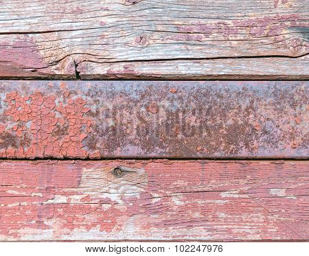 Old Horizontal Wooden And Iron Panels With Peeling Paint