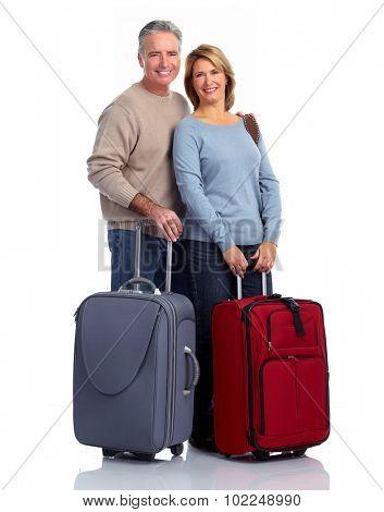 Senior couple with suitcase isolated white background.