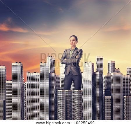 Woman standing among skyscrapers