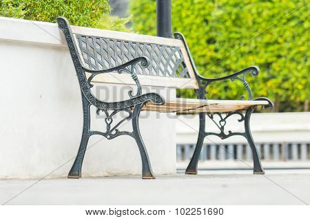 Stylish vintage bench in the public park.
