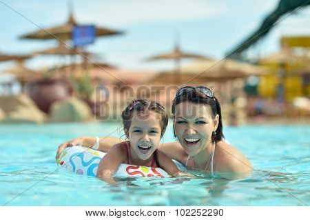 Family relax in  pool