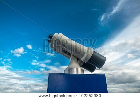 Tower viewer against blue cloudy sky