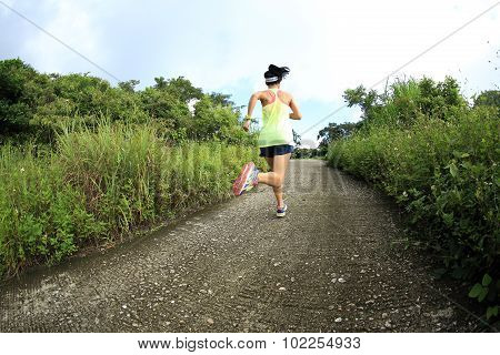young fitness woman trail runner running