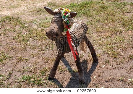 Wooden Horse Made By Hand With Ukrainian Colorful Hat On His Head