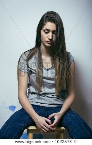 problem depressioned teenage with messed hair and sad face, real junky bad looking girl