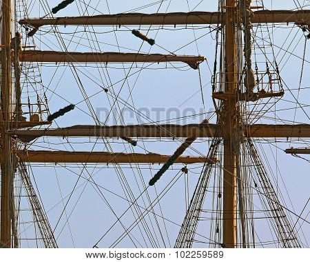 the mast of the frigate with removed sails against the sky