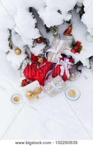 Christmas outdoor background with fir, gift boxes, decorations and candles