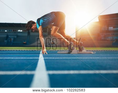 Professional Male Track Athlete In Set Position