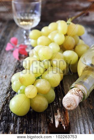 Green Grapes And A Bottle Of White Wine